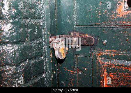 An Old Door And Padlock In Kilmainham Jail; Dublin, Dublin County, Ireland - Stock Photo
