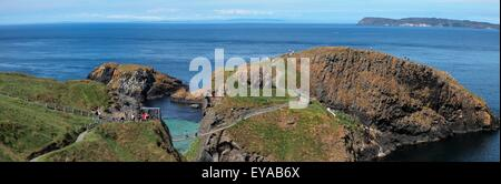 Carrick-A-Rede Rope Bridge In The Distance; Ballintoy, County Antrim, Northern Ireland - Stock Photo