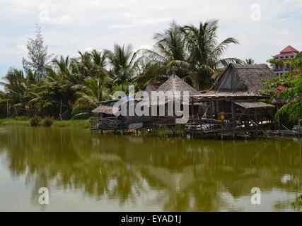 Stilt Houses on Thu Bon river in Hoi An - Stock Photo