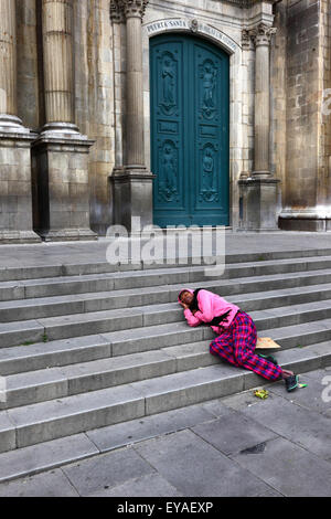 Homeless person asleep on main entrance steps to cathedral, Plaza Murillo, La Paz, Bolivia - Stock Photo
