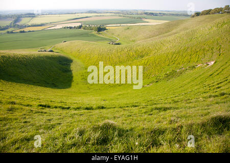 Summer view of arable fields and chalk landscape from Cherhill Down escarpment, Wiltshire, England, UK - Stock Photo