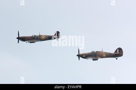 Sunderland, UK 25th July 2015. Battle of Britain Memorial Flight fighter planes Spitfire and Hurricane fly together - Stock Photo