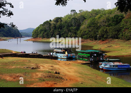 Pleasure boats getting ready for sight seeing trip at Thekkady Lake, part of Periyar Tiger Reserve and Wild Life - Stock Photo