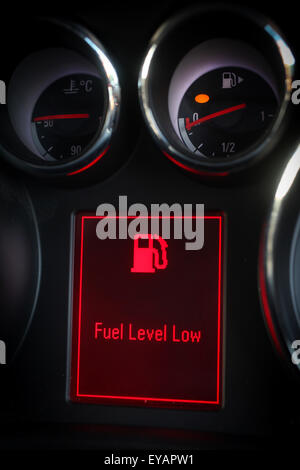 ... Low fuel warning light displayed on a car dashboard - Stock Photo & The warning light on the fuel gauge of a car is lit up orange in ... azcodes.com