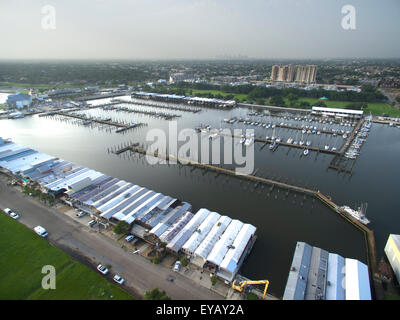 A view of Lakeview Marina in New Orleans, Louisiana on the shore of Lake Pontchartrain.  Many boats and boat houses - Stock Photo