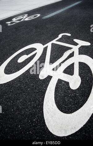 Bicycle Lane Sign Marking on Asphalt Road in Urban Outdoor Setting - Stock Photo