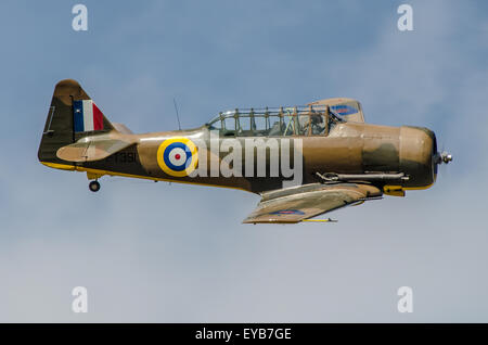North American T-6 Harvard (also known as Texan in US) flown by Richie Piper. Space for copy - Stock Photo