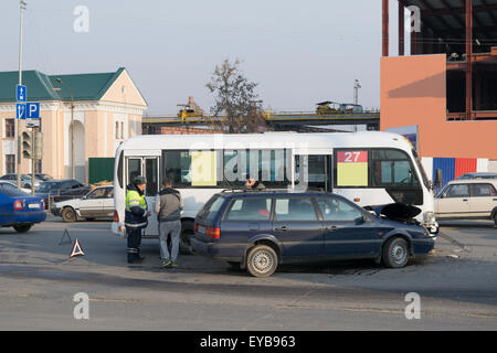 The inspector of traffic police (GAI) draws up a shuttle accident on the road - Stock Photo