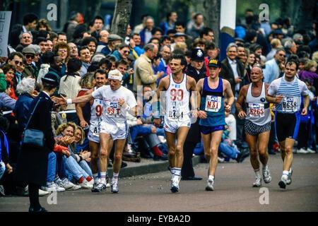 Jimmy Savile running along The Mall at the London Marathon 1989 - Stock Photo