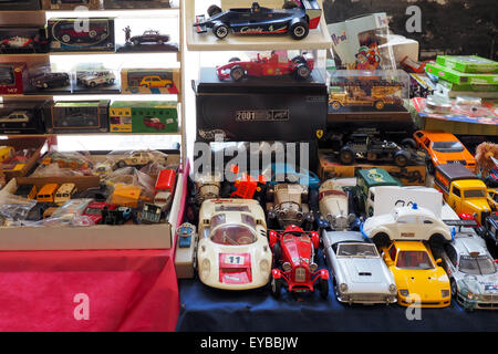 Collection of model cars on a table. - Stock Photo