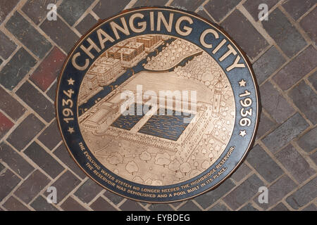 Bronze medallion in the walkway of the High Bridge connecting Manhattan with the Bronx over the Harlem River in - Stock Photo