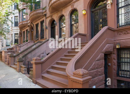 Romanesque Revival brownstone houses in Hamilton Heights / West Harlem in New York City. - Stock Photo