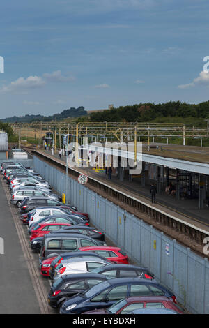 Leigh-on-Sea Railway Station with Parked Cars and Passengers Waiting for a Train - Stock Photo
