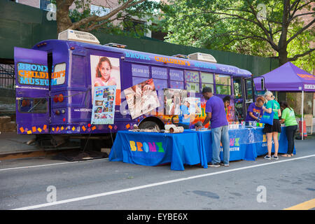 Volunteers from the Bronx Children's Museum on the Go Bus set up activities at the High Bridge Festival in New York - Stock Photo