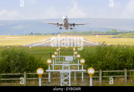 Plane taking off or landing at Manchester Airport - Stock Photo