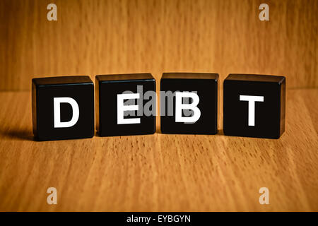 financial interest bearing debt text on black block - Stock Photo