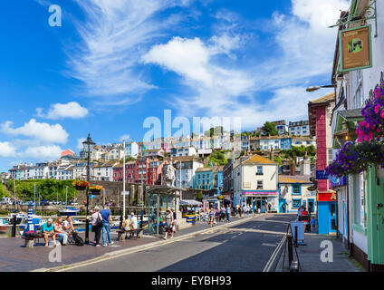 The Strand along the quayside in Brixham, Torbay, Devon, England, UK - Stock Photo