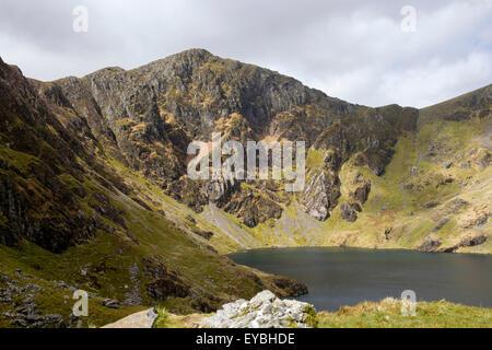 Llyn Cau lake in cwm below Craig Cau on Cadair Idris (Cader Idris) mountain range from Minffordd path. Southern - Stock Photo