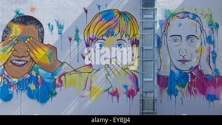 Barack Obama, Angela Merkel , Vladimir Putin street art mural on building - Stock Photo