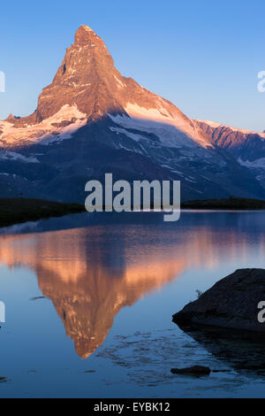 Sunrise on Matterhorn (Cervino) mountain. Reflection on Lake Stellisee, Zermatt, Swiss Alps. Switzerland. - Stock Photo