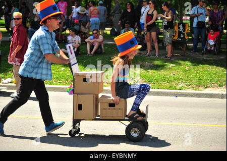 London, Ontario, Canada. 26th July, 2015. Thousands of people line the streets of London to view over 100 floats - Stock Photo