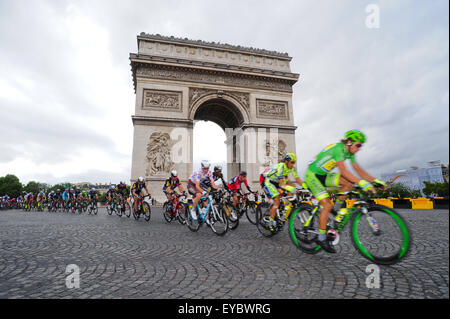 Paris, France. July 26, 2015. Riders by the Arc de Triomphe during the final Stage 21 of Tour de France in Paris. - Stock Photo