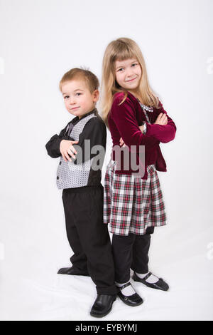 Three year old brother and six year old sister posing, showing a spunky attitude - Stock Photo