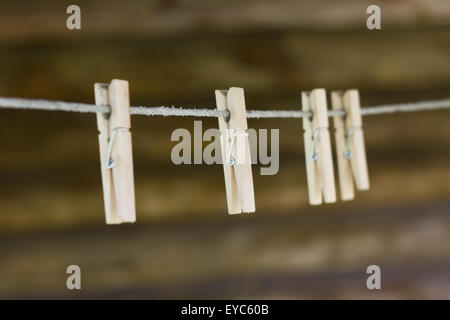Wooden clothespins on the clothesline - Stock Photo