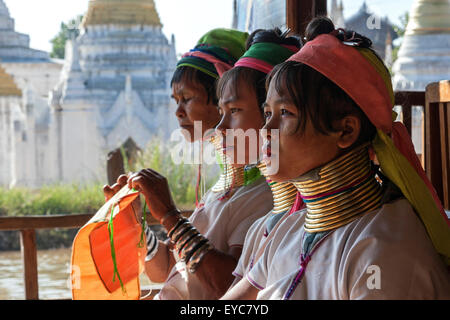 Women from the Padaung tribe in typical dress and headgear, necklaces, Inle Lake, Shan State, Myanmar - Stock Photo