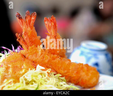 Shrimp  Fritter with  orange sauce and salad - Stock Photo