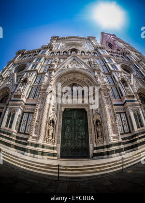 Fisheye lens shot of exterior of west front entrance of Florence Cathedral - The Cattedrale di Santa Maria del Fiore. - Stock Photo
