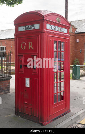 Unusual 1930s combined telephone kiosk and post box with stamp machines, Post Office K4 design, Whitley Bay, North - Stock Photo