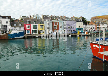 A view across Weymouth Harbour in Dorset to Trinity Road, from Custom House Quay. - Stock Photo