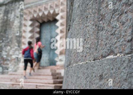 Trento, Italy, visitors at an entrance of the Castello del Buonconsiglio - Stock Photo