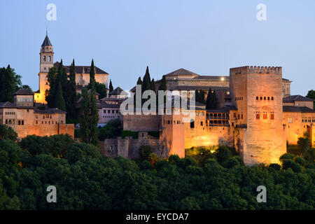 View of Alhambra Palace complex at dusk in Granada, Andalusia, Spain - Stock Photo