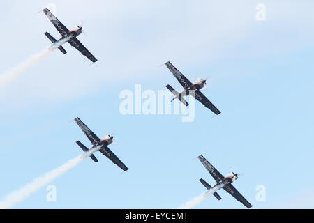 Sunderland, UK. 25th July, 2015. The Blades Aerobatic Display Team flying at the Sunderland Airshow in July 2015. - Stock Photo