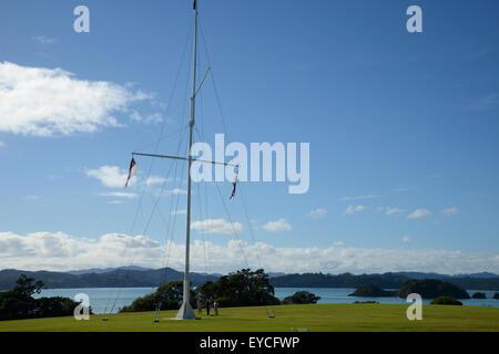 Treaty of Waitangi signed in the Bay of Islands in New Zealand. The flagstaff marks the spot where the Treaty of - Stock Photo