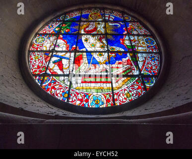 Circular stained glass window in dome of Florence Cathedral. Italy. - Stock Photo