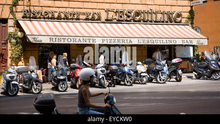 Rome, Vespas in front of a pizzeria - Stock Photo