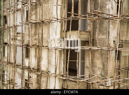 Construction site in Ethiopia with typical african scaffolding - Stock Photo