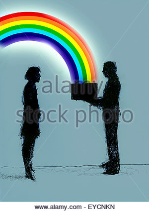 Businessman giving businesswoman box with rainbow - Stock Photo