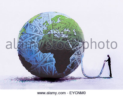 Businessman holding end of rope from unraveling globe ball - Stock Photo