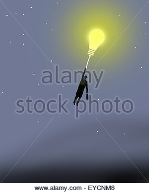 Businessman rising holding on to glowing light bulb balloon - Stock Photo