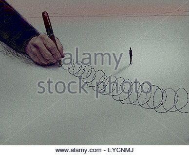 Large hand drawing barbed wire around trapped small man - Stock Photo