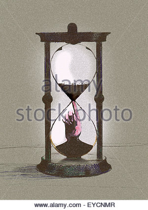 Hand inside of hourglass stopping time running out - Stock Photo