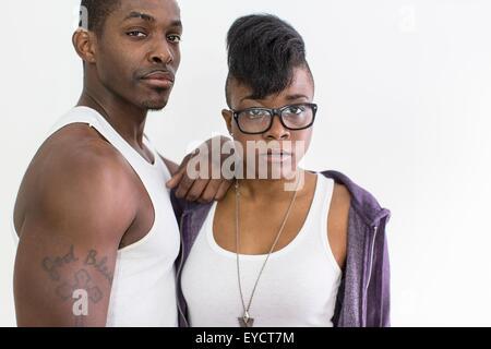 Studio portrait of cool confident couple - Stock Photo