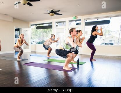Five people in yoga class - Stock Photo