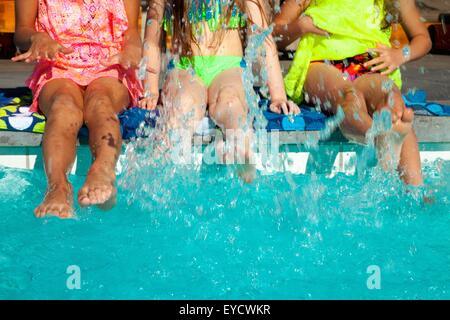 Girls paddling in swimming pool - Stock Photo