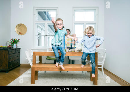 Family with three children in living room - Stock Photo