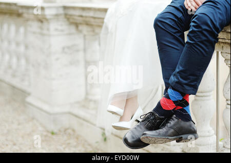bride and groom shoes and socks - Stock Photo